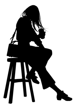 Long-haired woman with a drink sitting on a chair