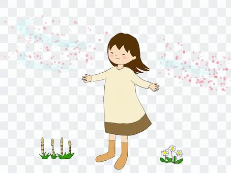 A girl who spreads her arms and receives the spring breeze