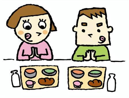 吃午餐的男孩和女孩