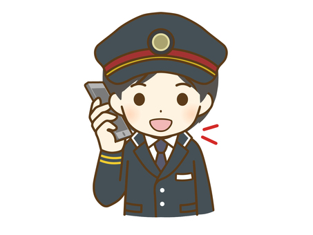 Young male station employee talking on the phone