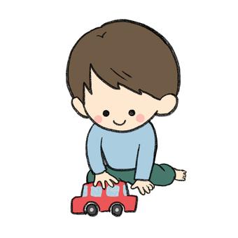 男孩玩汽車玩具