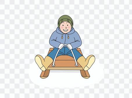一個男孩騎雪橇