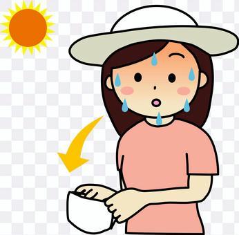 因中暑而臉色鮮紅並取下口罩的女性