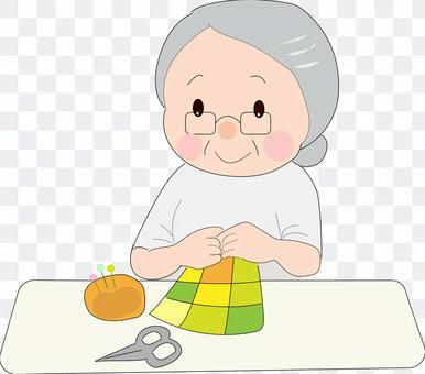 用手縫製的女人