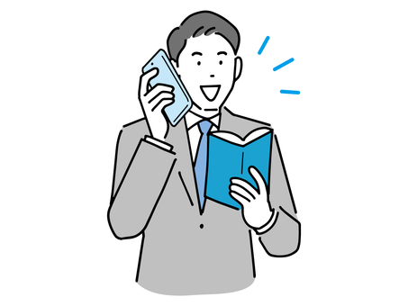 A businessman who holds a notebook and talks on a smartphone