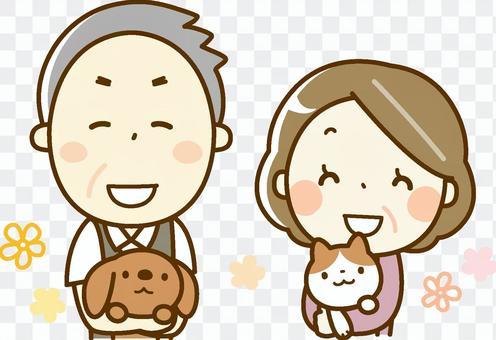 シニア夫婦 ペットを抱っこ