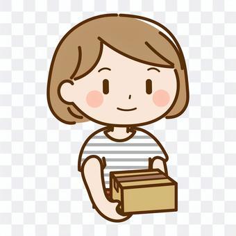 Housewife carrying cardboard