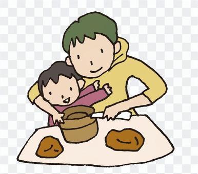 陶芸する親子