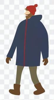 一個男人走在針織帽