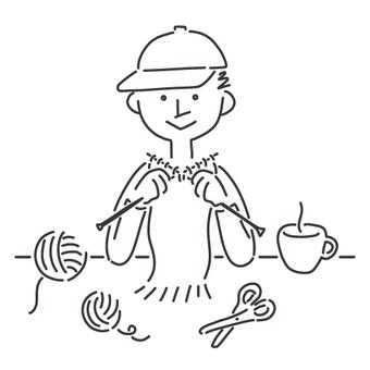 男孩戴著編織消聲器的帽子