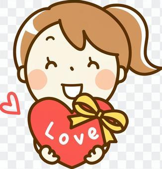 Girl giving Valentine's chocolate