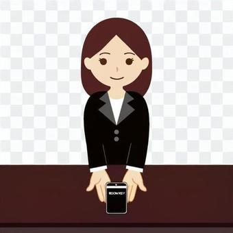 在旅館工作的一名婦女的前台的圖像