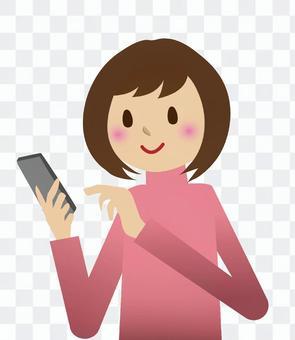 一個女人在看智能手機