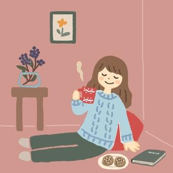 一個女人喝杯咖啡放鬆