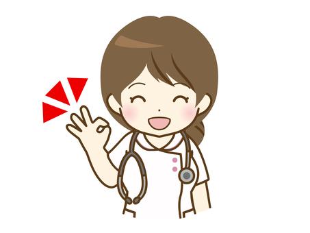 給一個好的標誌的年輕女性護士