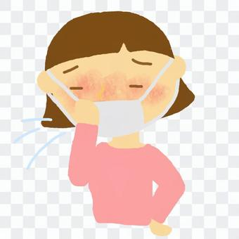 A girl who has a cold with a mask