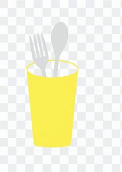 Fork and spoon in a glass