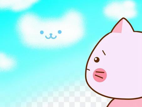 A cat looking up at a blue cloud
