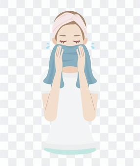 Women wiping their face with a skin care towel