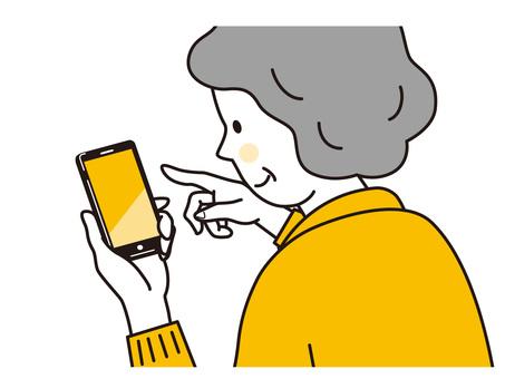 Senior woman operating a smartphone
