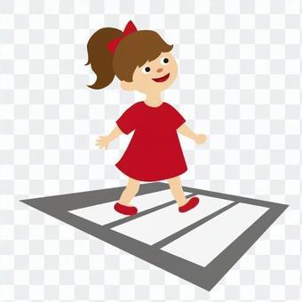 Girl crossing the crosswalk