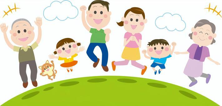 草原でジャンプする家族2