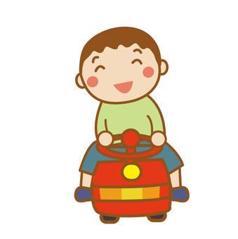 A boy riding a car toy