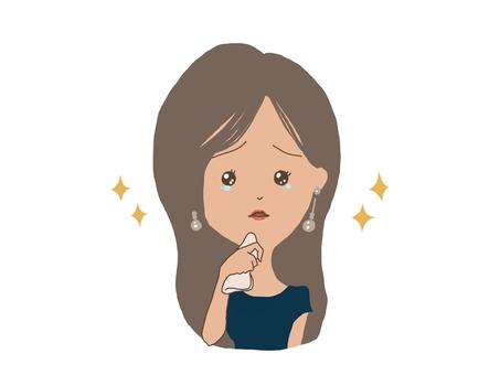一個女人拿著手帕,淚流滿面地仰望