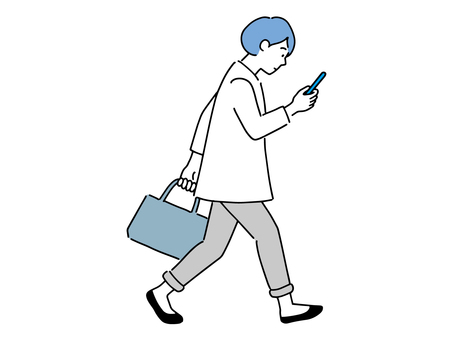 A woman walking while looking at a mobile phone