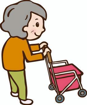Grandma pushing a silver car (back view)