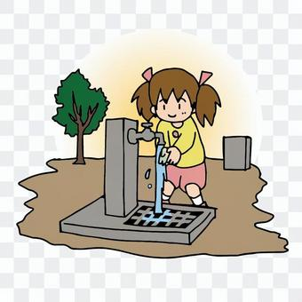 Children washing their hands in the water in the park, washing their hands outside