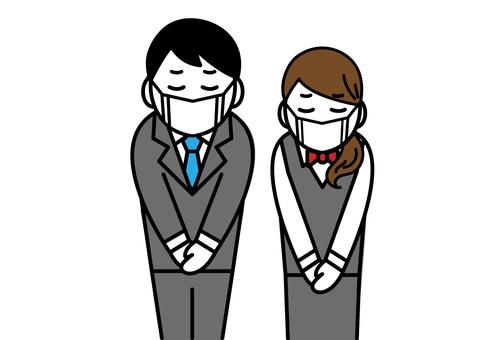 マスク姿で謝る男性と女性の会社員